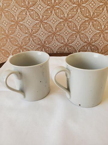 2 white stoneware coffee cups