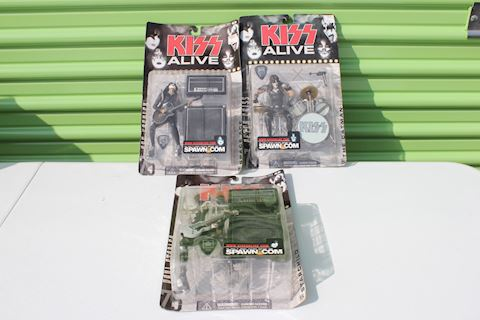 Three KISS Action Figures in Boxes