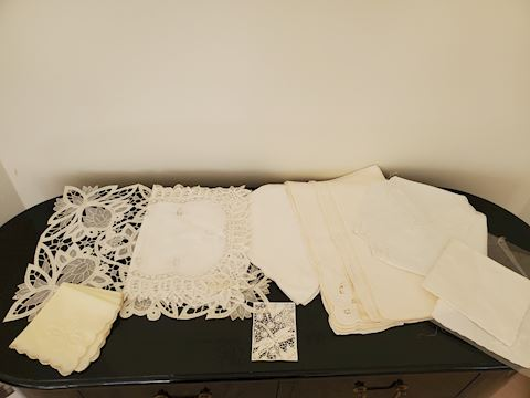 Various white and cream linens, napkins, placemats