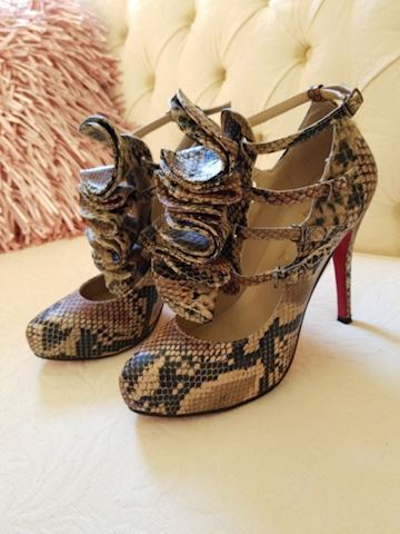 Christian Louboutin labelled snake ruffled heels
