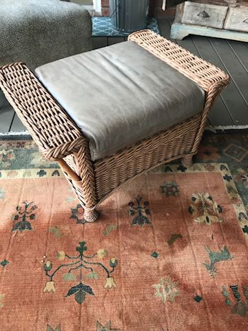 Wicker and leather ottoman