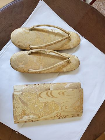 Gold clutch and matching slippers