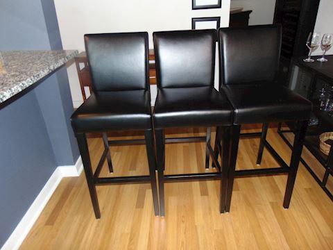 Three leather and oak bar stools