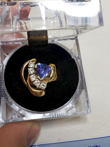 Custom Tanzanite and diamonds in 14k, size 8