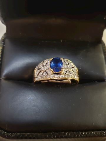 14k size 7,  1/2 ctw Sapphire and .46 diamonds