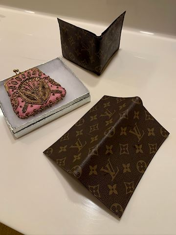wallet, checkbook and coin purse