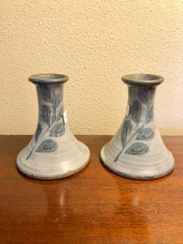Pottery candle sticks with leaf design