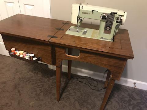 """White"" vintage cabinet sewing machine"