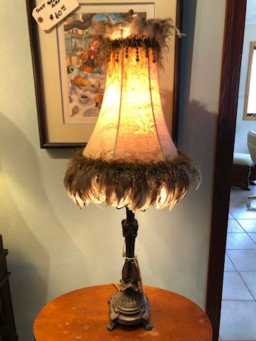 Decorative metal lamp with feathered shade