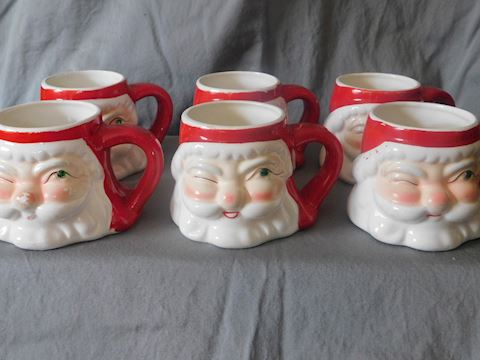 six winking santa mugs