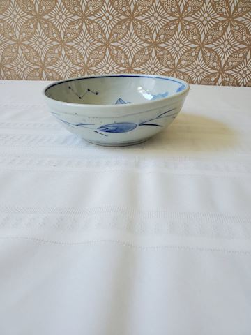 Blue painted Japanese bowl with boat and fish