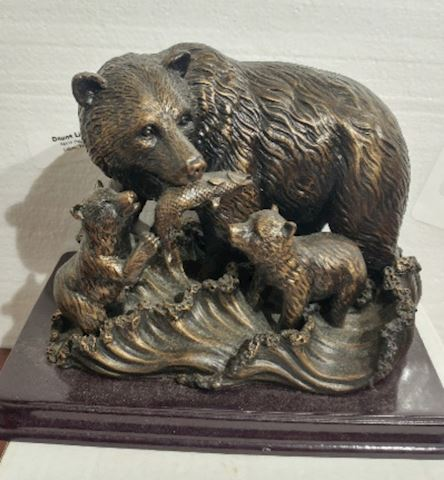 Bronze Bear Feeding Cubs