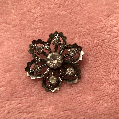 small flower brooch with rhinestones