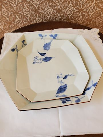 Two blue and white plates/platters with leaf desig