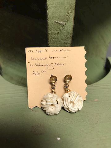Carved bone whimsy earring