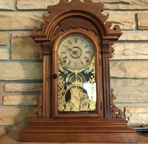 Antique walnut kitchen shelf clock with key, works
