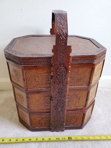Stacking basket with inlaid wood and carved design