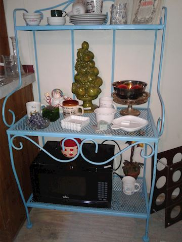 blue metal plant stand or baker's rack