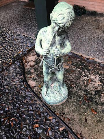 101.  Yard.  Little Boy Statue