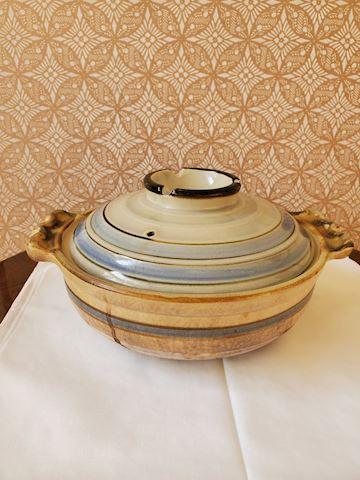 Blue and cream ceramic covered casserole dish.
