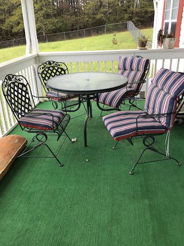 Great Wrought iron patio set and four chairs