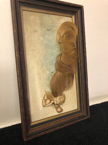 Antique in cased golden blonde hair