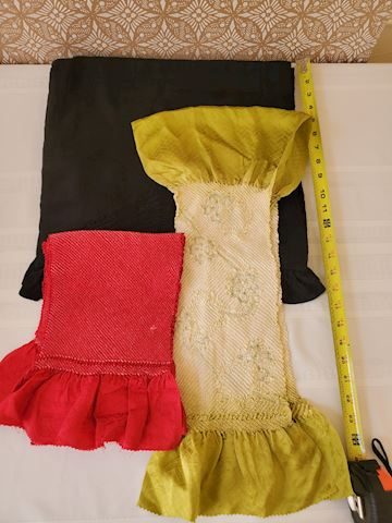 3 scarves, gold, black, and red print