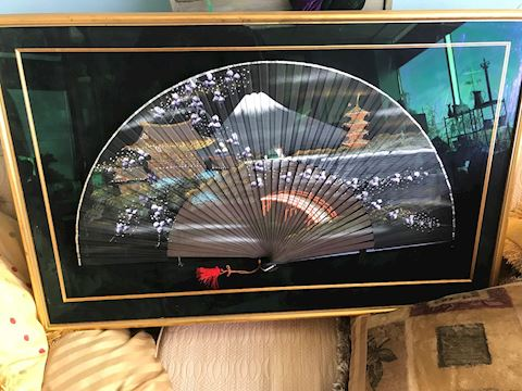 Hand Painted Fan in frame behind Glass