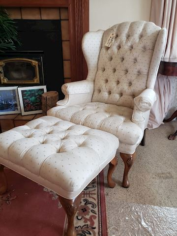 White tufted wing back chair and ottoman