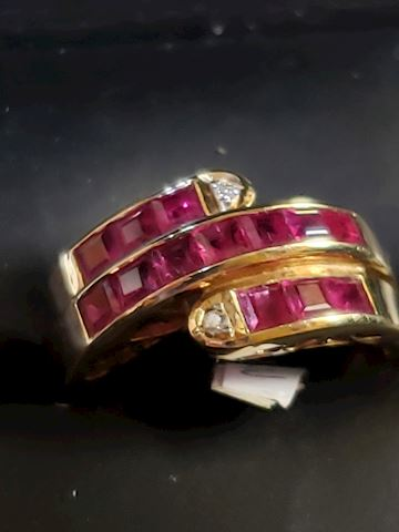 14k with Princess cut Rubies, size 7