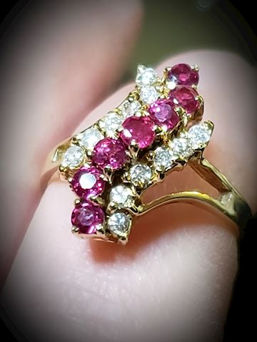 14k gold with approx .49ctw Rubies and .30ctw diam