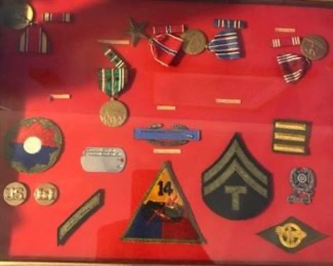 Military medals, photos, scrapbook, flag