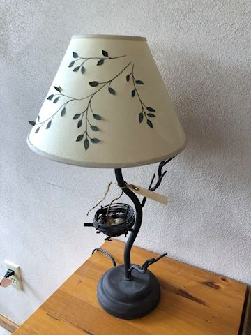 Metal lamp with bird's nest