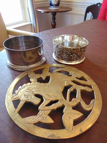 Two Wine Holders and One Brass Trivet