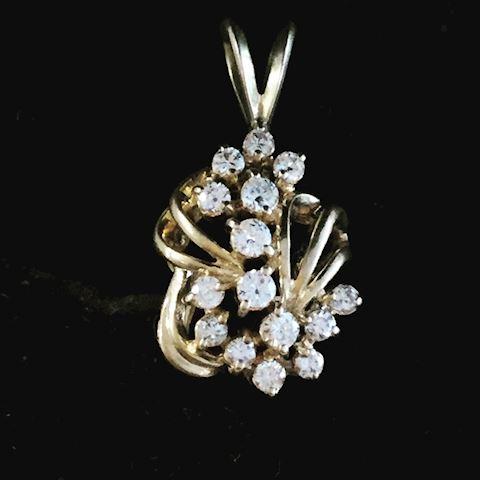 15 Diamond pendant 14 Kt gold