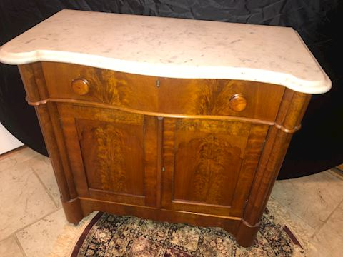Stone top antique cabinet