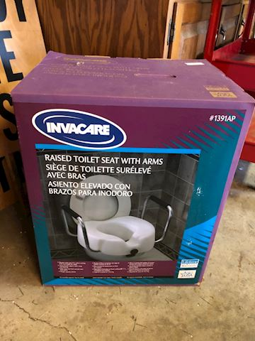 Invacare raised toilet seat with arms
