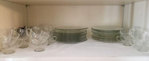 R 516   Clear glass cups and small plates