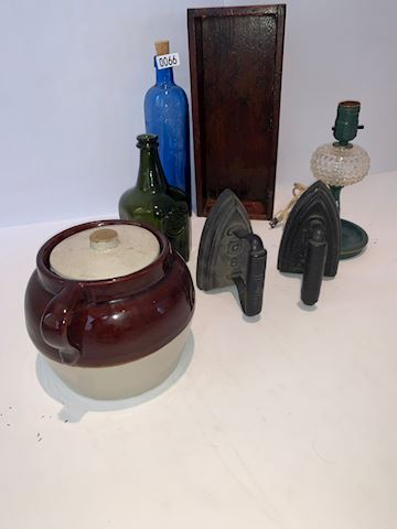 Lot 0066 Cast Irons and glass jars