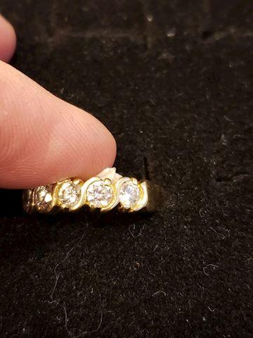 Size 7 approx .50ctw diamond 14k band