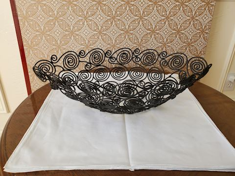 Black wire basket with scroll design