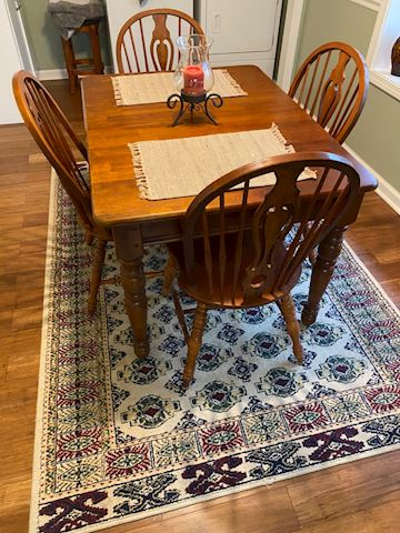 Beautiful solid wood table and chairs with leaf