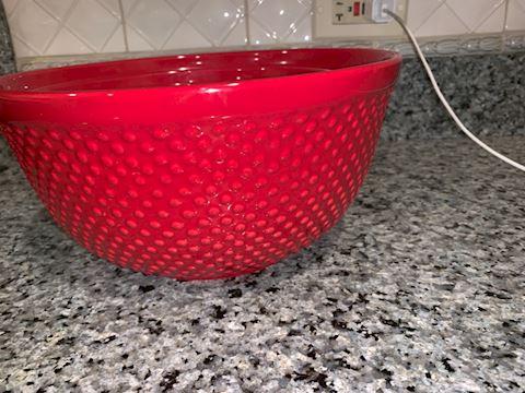 Three red ceramic mixing bowls