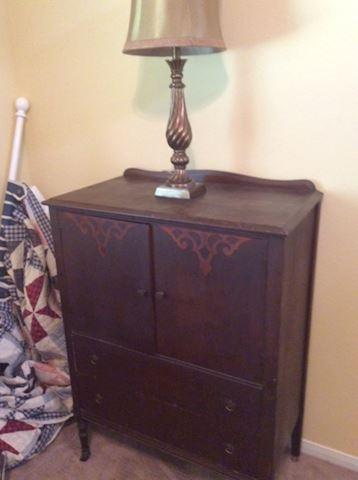 Vintage dresser with lamp
