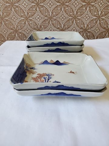 Set of 5 blue and white dishes with a scenic crane