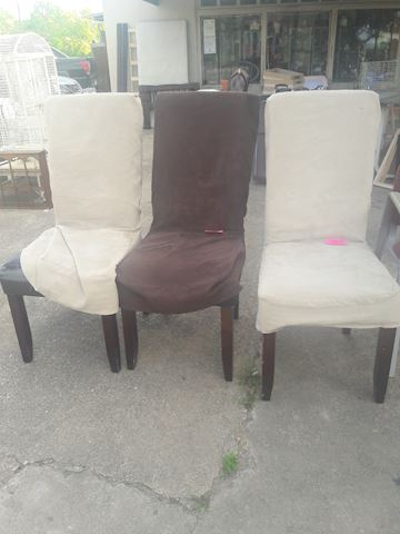 3 chairs with slip covers