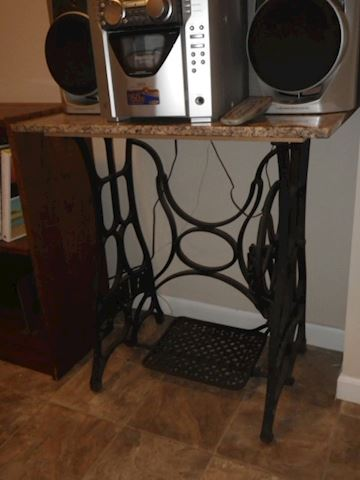 Table with sewing machine cast iron legs