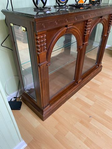 Glass display cabinet with marble top