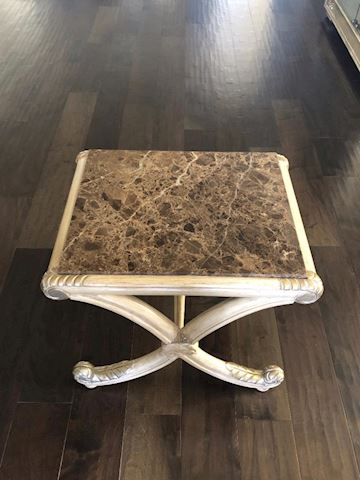 two end table with brown marble insert