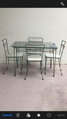 Iron and glass patio table and 4 chairs